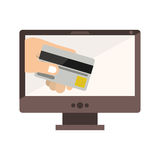 Desktop computer with display with credit card in hand Royalty Free Stock Image