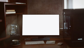 Desktop computer and monitor with blank white screen Royalty Free Stock Image