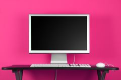 Desktop computer and pink wall Royalty Free Stock Images