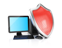 Desktop computer and shield Stock Photo