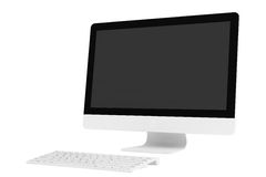 Desktop computer with wireless keyboard. On a white background Royalty Free Stock Photos