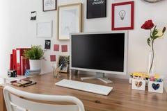 Desktop computer on wooden desk. Close-up of desktop computer on wooden desk Royalty Free Stock Image