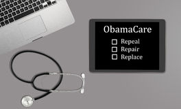 Desktop concept for Obamacare replacement. Healthcare concept with clean desk with medical and healthcare equipment with copyspace for message about Obamacare Stock Photo