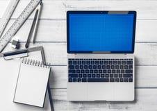 Desktop criativo do desenhista e do arquiteto com artigos do portátil e dos artigos de papelaria Zombaria acima Imagens de Stock