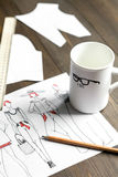 Desktop designer clothes with tools at wooden table Stock Images