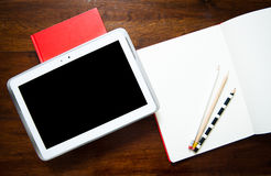 Desktop detail with notepad and note book Royalty Free Stock Photos