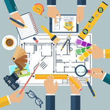 Architect designer, project drawings. Team of people working together to plan repair project, construction of house. Teamwork on architectural planning Royalty Free Stock Image