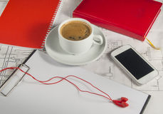 Desktop with the drawings,  red diary, mobile phone, coffee Royalty Free Stock Images