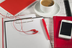 Desktop with the drawings,  red diary, mobile phone, coffee Royalty Free Stock Photography