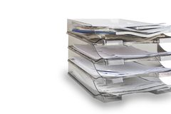 Desktop filing drawers full of papers on the white. Paper office tray.  stock photo