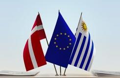 Flags of Denmark EU and Uruguay. Desktop flags of Denmark and Uruguay with European Union flag in the middle stock photos