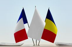 Flags of France and Chad. Desktop flags of France and Chad with white flag in the middle royalty free stock image