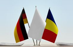 Flags of Germany and Chad. Desktop flags of Germany and Chad with white flag in the middle royalty free stock image