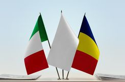 Flags of Italy and Chad. Desktop flags of Italy and Chad with white flag in the middle stock photos