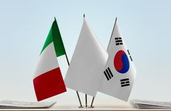 Flags of Italy and South Korea. Desktop flags of Italy and South Korea with white flag in the middle stock image