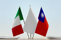 Flags of Italy and Taiwan. Desktop flags of Italy and Taiwan with white flag in the middle stock photos