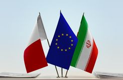 Flags of Malta EU and Iran. Desktop flags of Malta and Iran with European Union flag in the middle royalty free stock images