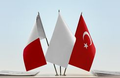 Flags of Malta and Turkey. Desktop flags of Malta and Turkey with a white flag in the middle royalty free stock photos