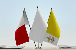 Flags of Malta and Vatican City. Desktop flags of Malta and Vatican City with a white flag in the middle Royalty Free Stock Images