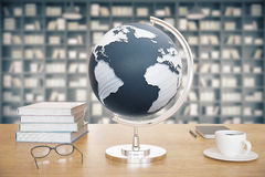 Desktop with globe Stock Photography