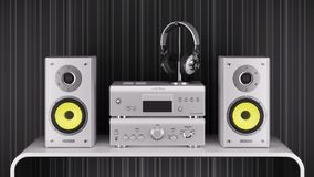Desktop Hi-Fi speakers, stereo amplifier and headphones are silv Stock Photo