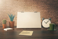 Desktop with items brick background Royalty Free Stock Images