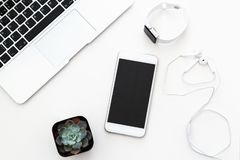 Free Desktop Items: Laptop, Succulent, Notebook, Headphones, Mobile Phone, Watch Lying On White Background. Flat Lay, Top View, Royalty Free Stock Photography - 147458027