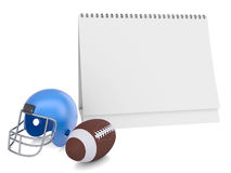 Desktop kalendarz, futbolowy hełm i piłka, Obrazy Stock