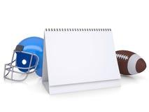 Desktop kalendarz, futbolowy hełm i piłka, Obrazy Royalty Free