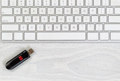 Desktop with keyboard and data thumb drive Royalty Free Stock Photos