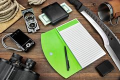 Desktop With Large Group Of  Objects For Travel, Expedition, Exp. Multifunctional Tools for expedition or active lifestyle: Camera, Notebook, Knife, Machete Royalty Free Stock Photo