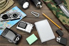 Desktop With Large Group Of  Objects For Travel, Expedition, Exp. Objects for Traveling and Active Lifestyle, Laying on the Rough Wooden Table, Including Camera Stock Images
