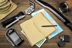 Desktop With Large Group Of Objects For Travel, Expedition, Exp. Objects for Traveling and Active Lifestyle, Laying on the Rough Wooden Table, Including Cup Stock Images
