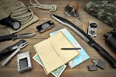 Desktop With Large Group Of Objects For Travel, Expedition, Exp. Objects for Traveling and Active Lifestyle, Laying on the Wooden Table, Including Camera Torch Stock Photography