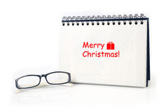 Desktop Loop wire binding book with Merry Christmas text and mod Stock Images