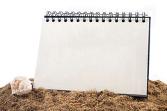 Desktop Loop wire binding book on sand and  isolated white backg Stock Image