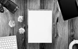 Desktop mix on a wooden. Black and white royalty free stock photo