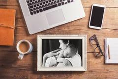 Desktop mix on a wooden office table. Stock Photos