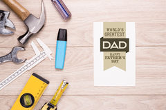 Fathers Day tag with tools on wood. Stock Photography
