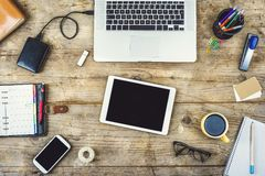Desktop mix on a wooden office table. royalty free stock photo