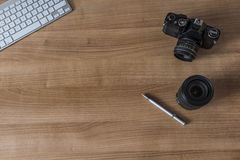 Desktop with modern keyboard and camera Royalty Free Stock Image