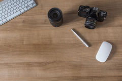 Desktop with modern keyboard and camera Royalty Free Stock Photos