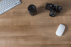 Desktop with modern keyboard and camera Royalty Free Stock Photo