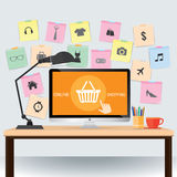 Desktop with Note paper and basket online shopping icons Stock Photos