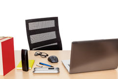 Desktop with a notebook Royalty Free Stock Image