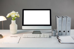 Desktop pc with flower vase and files Stock Photos