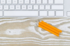 Desktop with pencils and keyboard Stock Photography