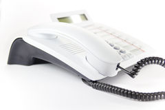 Desktop phone. White modern enterprise desktop phone Stock Photography