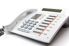 Desktop phone. White modern enterprise desktop phone Stock Images