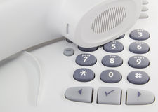 Desktop phone. White modern enterprise desktop phone Royalty Free Stock Photo